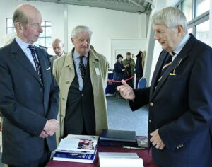 During his visit to the County Show at Detling the Duke of Kent, pictured left, accompanied by the Lord- Lieutenant, Viscount De L'Isle, centre, stopped to have a word with David McDine, author of the newly published book Unconquered - The Story of Kent and its Lieutenancy . He commented : 'Everyone here should buy one!' (c) Barry Duffield.