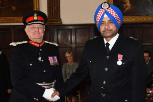 Mr Pirthipal Singh Kang receiving his medal from the Lord-Lieutenant for Services to Fire and Rescue Awareness and Community Cohesion in North Kent. (c) Barry Duffield DL