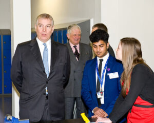 The Duke of York with Head Boy,Ryan Robi, and Head Girl, Rebecca Driver during his tour. (c) Adam Knott.