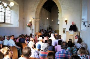 The Reverend David Green with parishioners in the beautiful church dating back to the 13th century. (c) Mike Rowe.