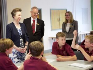 HRH enjoying a joke with pupils. (c) Ali Kittermaster of Blush Photography.