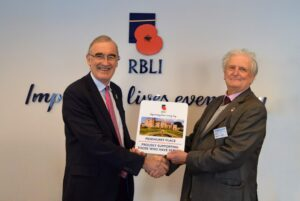Mr Steve Sherry, Chief Executive of RBLI pictured left, presenting a plaque to the Lord-Lieutenantof Kent which was manufactured on the premises. (c) RBLI
