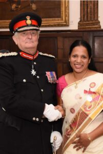 Dr Agimol Pradeep being congratulated by the Lord-Lieutenant. (c) Barry Duffield DL.