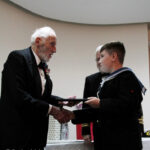 Rear Admiral John Roberts presenting Mariner Lee Gumbrill with his certificate.(c) Rachel Adams Photography.