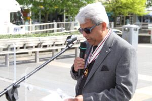 Dr Bhargawa Vasudaven DL, representing the Lord-Lieutenant, speaking at the event. (c) Kent Equality Cohesion Council.