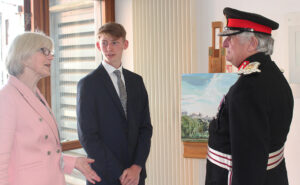 The Lord-Lieutenant talking to Margaret Williams, Chair of Governors, and Jacob Eason, Year 12, about the Wye School art exhibition at 10 Downing Street.(c) Wye School.