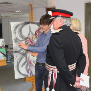 Owen McMahon, Year 12, talking to the Lord-Lieutenant about his artworks that were exhibited at 10 Downing Street. (c) Wye School.