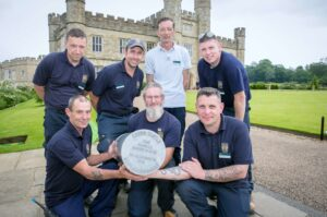 Leeds Castle staff holding the Time Capsule. (c) Leeds Castle.