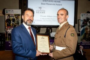 Mr Robin Duncan, Company Secretary, presenting Private William Underdown, C (Royal West Kent) Company, 3rd Battalion, PWRR, with the Shepherd Neame Best Reservist Award. (c) Stewart Turkington.